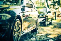Tvagning för två bilar Arkivfoto