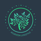 TVector tree logo. Ayurvedic symbol. On dark beckground. Ayurvedic emblem for alternative spa design Royalty Free Stock Image