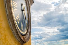 Tver region, Ostashkov, Russia. Nilo-Stolobensky Monastery at the Seliger lake, Russia, closeup of bell tower clock. On the background of stormy sky stock photos