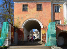 Tver, Russia - may 07.2017. Family walks through the arch in building of the old river terminal. Tver, Russia - may 07.2017. Family walks through the arch in the Stock Photography