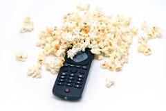 TVfjärrkontroll och popcorn Royaltyfri Foto