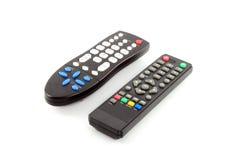 TVfjärrkontroll på vit bakgrund Arkivfoto