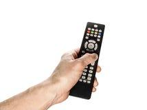 TVfjärrkontrollen i handen som isoleras på vit bakgrund Royaltyfri Foto