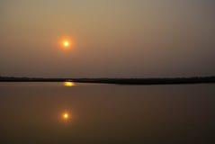 tvilling- solnedgång Royaltyfri Foto
