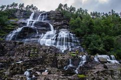 Tvindefossen waterfall in Norway photographed on long exposure during dusk royalty free stock photography