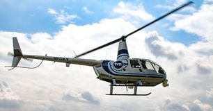 TVN24 news tv helicopter in flight. Polish news tv TVN24 blekitny Robinson R44 Raven helicopter in flight. Photo taken from ground during air show in Radom 2008 Royalty Free Stock Image