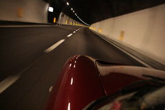 TVR in Mont Blanc. TVR sports car speeds through the Mont Blanc tunnel Royalty Free Stock Photo