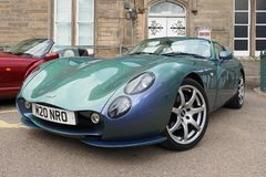 TVR Tuscan MKII in Chameleon Blue. TVR Tuscan MK2 in flip Chameleon blue/green paint, with a straight six 3.6lt engine built in 2005. Grantown on Spey royalty free stock image