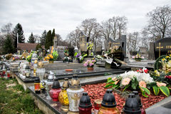 TVRDOMESTICE, SLOVAKIA - 12.3.2016: Graves, tombstones and crucifixes on traditional cemetery. Votive candles lantern and flowers Stock Photography