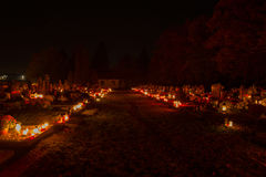 TVRDOMESTICE, SLOVAKIA - 2.11.2015: Votive candles lantern burning on graves in cemetery at night time. All Hallows eve. TVRDOMESTICE SLOVAKIA - 2.11.2015 Stock Images