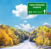 TWÓJ opinia LICZY drogowego znaka przeciw jasnemu niebieskiemu niebu zdjęcia stock