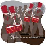 Twaalf slagwerkers die Twaalf dagen van Kerstmis trommelen Stock Foto's