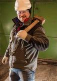 Twardy pracownik z żelazo młotem i łańcuchem fotografia royalty free