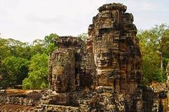 Twarz góruje Bayon świątynia W centrum Angkor Thom, Siem Przeprowadza żniwa, Kambodża Unesco Światowego Dziedzictwa Miejsce Obrazy Stock
