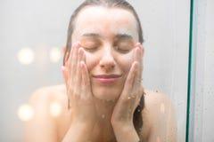 twarz kobiety prania Zdjęcie Royalty Free