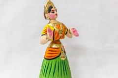 Twarz Thanjavur dancingowa lala Dzwoniąca jako Thalaiyatti Bommai w Tamilskim języku z spojrzenie podobną tradycyjną suknią oranm Obraz Royalty Free