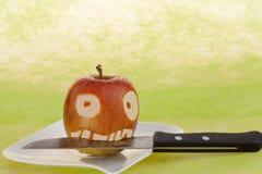 Twarz w jabłku Zdjęcia Stock