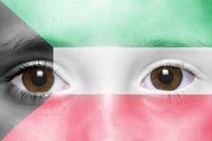 twarz z Kuwait flaga Fotografia Stock