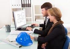 Twee architecten of structurele ingenieurs Royalty-vrije Stock Afbeeldingen