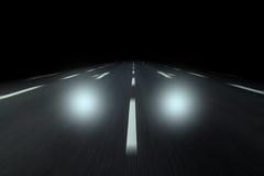 Twee autolicht op weg royalty-vrije stock afbeeldingen