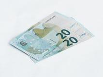 Twee bankbiljetten met een waarde van 20 die Euro op een witte achtergrond wordt geïsoleerd Stock Foto's