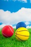 Twee basketbal en een tennisball Royalty-vrije Stock Foto's
