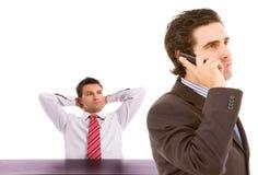 Twee bedrijfsmens op een bureau Stock Foto