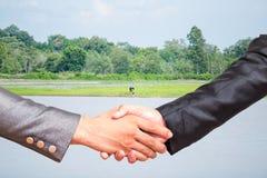 Twee bedrijfsmensenhanddruk Stock Foto