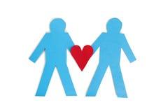 Twee blauwe stokcijfers die een rood hart over witte achtergrond houden Stock Afbeelding