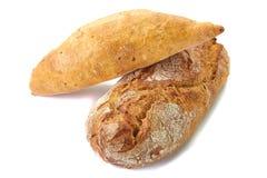 Twee broden van brood op wit Royalty-vrije Stock Afbeeldingen