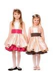Twee charmante meisjes in een kleding stock afbeelding