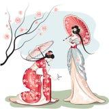 Twee Chinese vrouwen met parasols Stock Fotografie