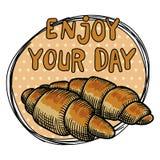 Twee croissants op een beige stipplaat en een inschrijving GENIETEN van UW DAG Uit de vrije hand tekening royalty-vrije illustratie