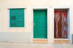 Twee deuren en venster Stock Afbeeldingen