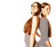 Twee die jonge werknemers op witte, zelfde kleding in strook worden geïsoleerd royalty-vrije stock fotografie