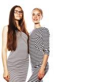 Twee die jonge werknemers op witte, zelfde kleding in strook worden geïsoleerd royalty-vrije stock foto's