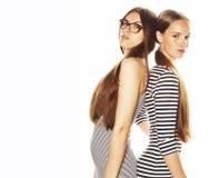 Twee die jonge werknemers op witte, zelfde kleding in strook worden ge?soleerd royalty-vrije stock fotografie