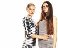 Twee die jonge werknemers op witte, zelfde kleding in strook worden ge?soleerd stock afbeelding