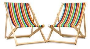 Twee die ligstoelen tegen een wit worden geïsoleerd Royalty-vrije Stock Foto's