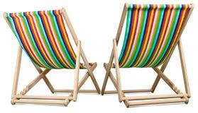 Twee die ligstoelen tegen een wit worden geïsoleerd Stock Afbeelding