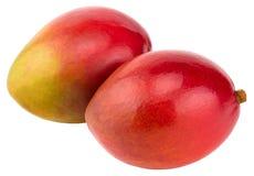 Twee die mango's op witte achtergrond het Knippen Weg worden geïsoleerd stock foto's