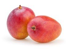 Twee die mango's op witte achtergrond worden geïsoleerd Royalty-vrije Stock Foto