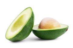 Twee die plakken van avocado op een witte achtergrond wordt geïsoleerd Één plak Royalty-vrije Stock Foto