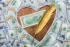 Twee dollars op een bronsachtergrond in de vorm van een hart royalty-vrije stock afbeeldingen