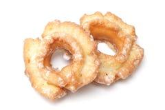 Twee donuts die op wit wordt geïsoleerdo Stock Afbeeldingen