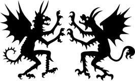 Twee duivelssilhouetten Stock Foto