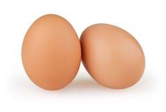 Twee eieren op wit stock afbeeldingen