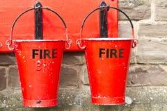 Twee Emmers van de Brand Stock Afbeeldingen