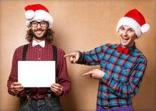 Twee emotionele Santa Claus Royalty-vrije Stock Afbeeldingen