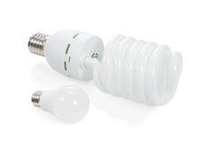 Twee energy-saving lampen Stock Afbeeldingen